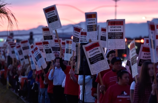 Culinary Union members picket along Sahara Avenue at the Palace Station hotel-casino Friday, Feb. 12, 2016, in Las Vegas. About 500 members and family voiced their displeasure no union representat ...