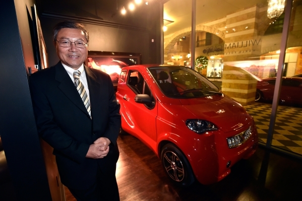 Michael Hu, president and CEO of 2050 Motors stands with his e-Go prototype, an all electric and carbon fiber body automobile at the William Carr Gallery at Tivoli Village Friday, Feb. 12, 2016, i ...