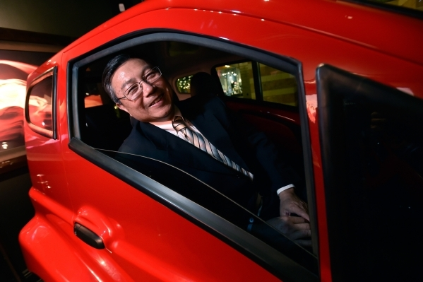 Michael Hu, president and CEO of 2050 Motors peers out the window of his e-Go prototype, an all electric and carbon fiber body automobile at the William Carr Gallery at Tivoli Village Friday, Feb. ...