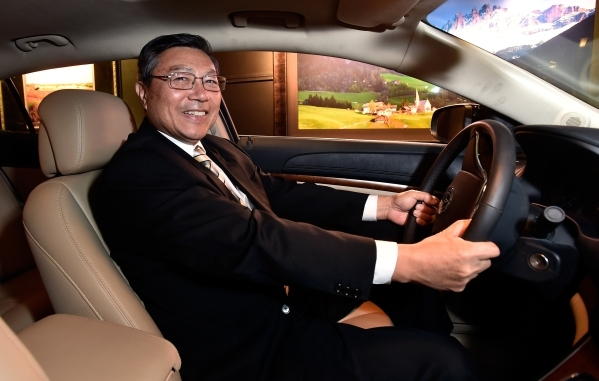 Michael Hu, president and CEO of 2050 Motors sits in the driver's seat of his Ibis prototype, an all electric and carbon fiber body automobile at the William Carr Gallery at Tivoli Village F ...