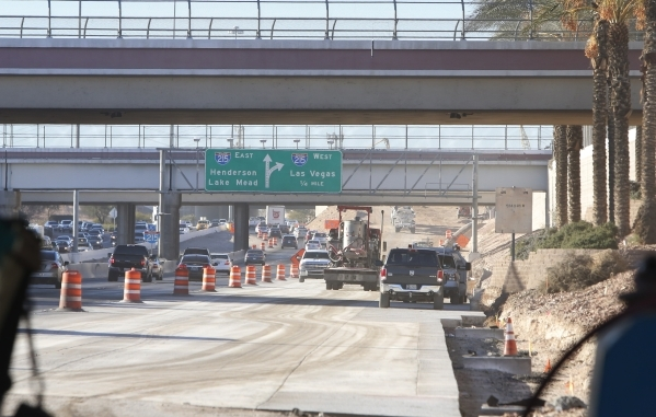 Crews reconstruct a ramp on Paradise Road linking to the 215 Beltway on Tuesday, Feb. 9, 2016. The ongoing construction of the Airport Connector Project will reduce the number of travel lanes on a ...