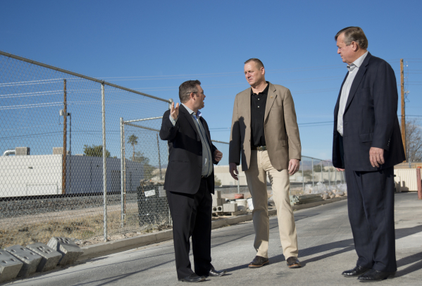 U.S. Rep. Cresent Hardy, R-Nev., right, and U.S. Rep. Jeff Denham, R-Calif., center, listen as Brandon Taylor guides them on a tour of GeoTek, his consulting engineering firm near McCarran Interna ...