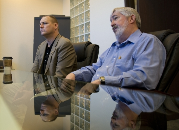 U.S. Rep. Jeff Denham, R-Calif., left, and Bill Taylor of GeoTek, a consulting engineering firm near McCarran International Airport, sit in a meeting room inside GeoTek on Monday, Feb. 15, 2016. D ...