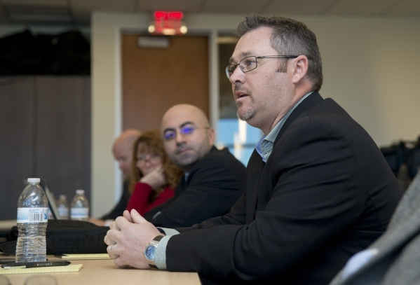 Brandon Taylor of GeoTek, a consulting engineering firm, asks a question during a roundtable discussion on transportation issues with U.S. Rep. Cresent Hardy, R-Nev., and U.S. Rep. Jeff Denham, R- ...