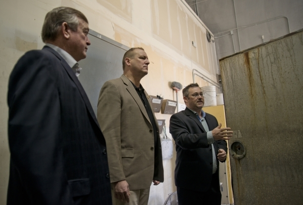 U.S. Rep. Cresent Hardy, R-Nev., left, and U.S. Rep. Jeff Denham, R-Calif., center, listen as Brandon Taylor guides them on a tour of GeoTek, his consulting engineering firm near McCarran Internat ...