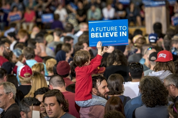 A child holds a sign during a rally for Democratic presidential candidate Bernie Sanders at Bonanza High School in Las Vegas on Sunday, Feb. 14, 2016. Joshua Dahl/Las Vegas Review-Journal