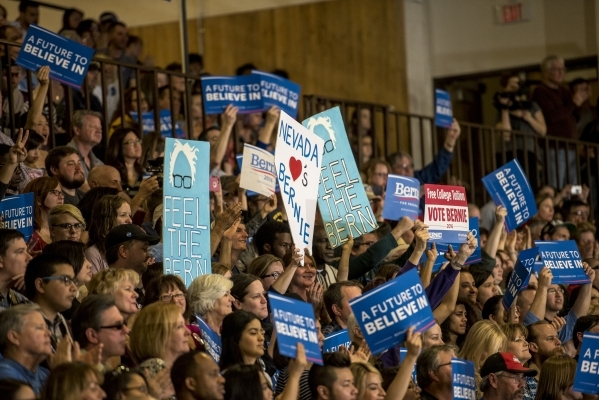 Supporters hold signs during a rally for Democratic presidential candidate Bernie Sanders at Bonanza High School in Las Vegas on Sunday, Feb. 14, 2016. Joshua Dahl/Las Vegas Review-Journal