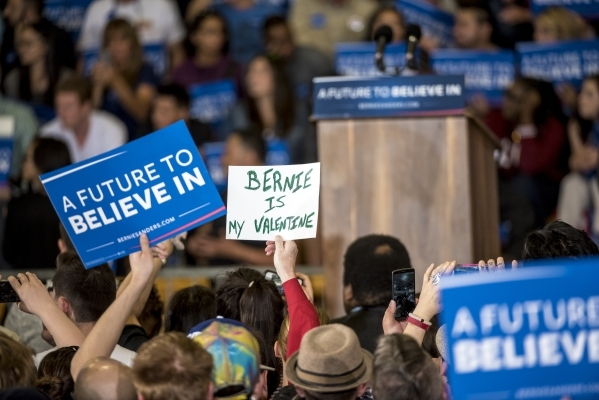A supporter holds a sign during a rally for Democratic presidential candidate Bernie Sanders at Bonanza High School in Las Vegas on Sunday, Feb. 14, 2016. Joshua Dahl/Las Vegas Review-Journal
