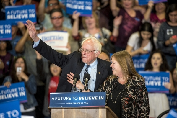 Democratic presidential candidate Bernie Sanders and his wife Jane wave to the crowd during a rally at Bonanza High School in Las Vegas on Sunday, Feb. 14, 2016. Joshua Dahl/Las Vegas Review-Journal