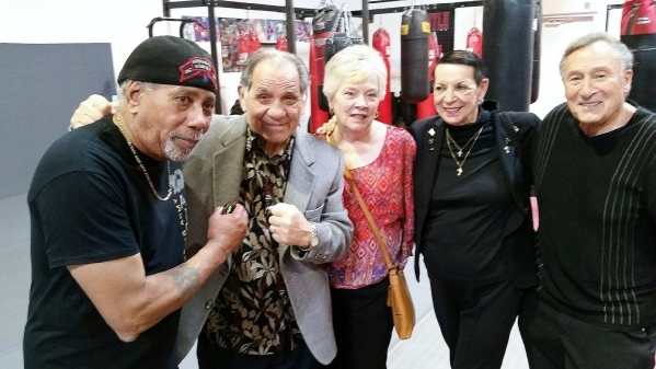 Former undisputed welterweight boxing champion Tony DeMarco, second from left, poses for a photo at the Long Life Fighter Gym on Patrick Lane in Las Vegas on Feb. 9, 2016. Others pictured, from le ...