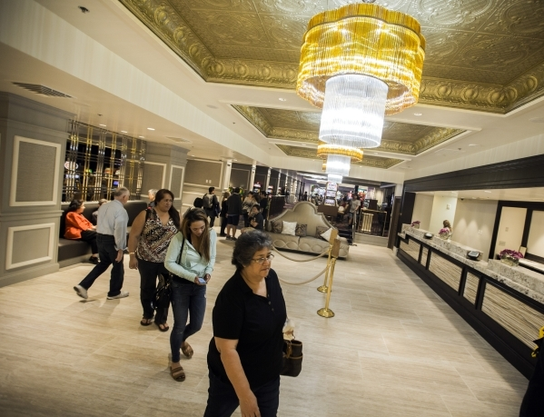 People walk in the recently remolded lobby area of the California Hotel & Casino,12 East Ogden Avenue, on  Tuesday, Feb, 16, 2016.  Boyd Gaming  is spending $100M to upgrade property. Jeff Sch ...