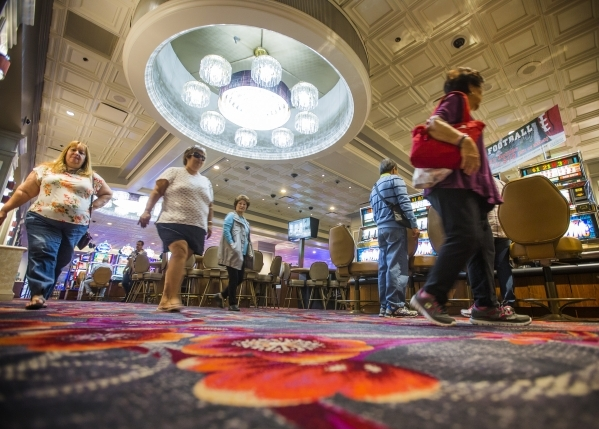 People walk in the recently remolded gaming area of the California Hotel & Casino, 12 East Ogden Avenue, on  Tuesday, Feb, 16, 2016.  Boyd Gaming is spending $100M to upgrade property. Jeff Sc ...