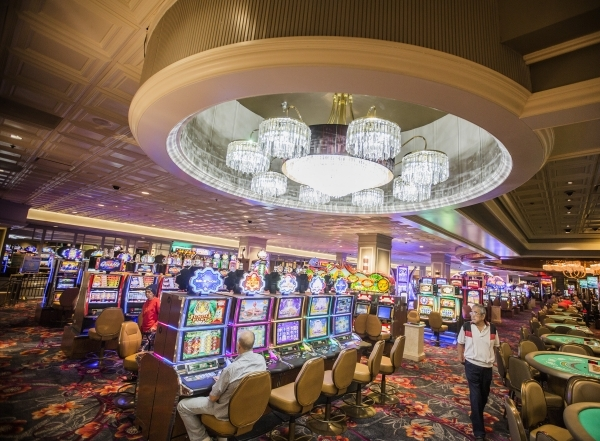 People walk in the recently remolded gaming area of the California Hotel & Casino,12 East Ogden Avenue, on  Tuesday, Feb, 16, 2016.  Boyd Gaming  is spending $100M to upgrade property. Jeff Sc ...