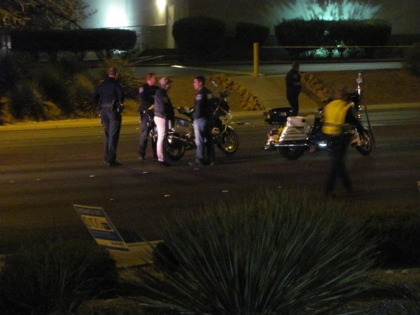 Police work at the scene of an auto-pedestrian accident on Lake Mead Boulevard just east of Rancho Drive on Monday, Feb. 15, 2016. North Las Vegas police said a man was critically injured in the c ...