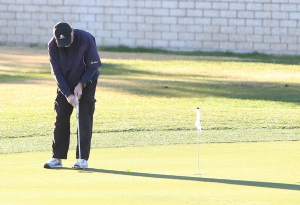 """A golfer prepares to putt as he plays a round of golf on a warm Presidents Day at Legacy Golf Club in Henderson, Monday, Feb. 15, 2016. The low overnight temperature was a """"fair amount warmer ..."""