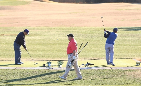 """Golfers practice their swing during a warm morning at Legacy Golf Club in Henderson, Monday, Feb. 15, 2016. The low overnight temperature was a """"fair amount warmer than the past few nights&qu ..."""