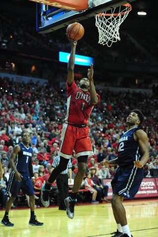 UNLV forward Derrick Jones Jr. (1) goes up for a shot against UNR guard Tyron Criswell (2) in the first half of their NCAA college basketball game against UNLV at the Thomas & Mack Center in L ...