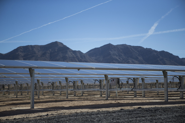 The completed second solar-power project, a 15-megawatt photovoltaic panel array on a 102-acre site near the base golf course inside Nellis Air Force Base, is seen during a dedication ceremony of  ...