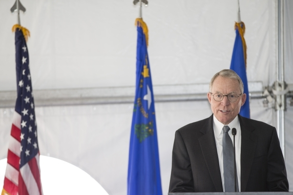 Paul Caudill, president and CEO of NV Energy, speaks during a dedication ceremony of the completed second solar-power project at Nellis Air Force Base, a 15-megawatt photovoltaic panel array on a  ...