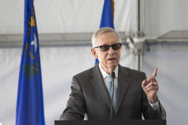 U.S. Rep. Harry Reid, D-Nev., speaks during a dedication ceremony of the completed second solar-power project at Nellis Air Force Base, a 15-megawatt photovoltaic panel array on a 102-acre site ne ...