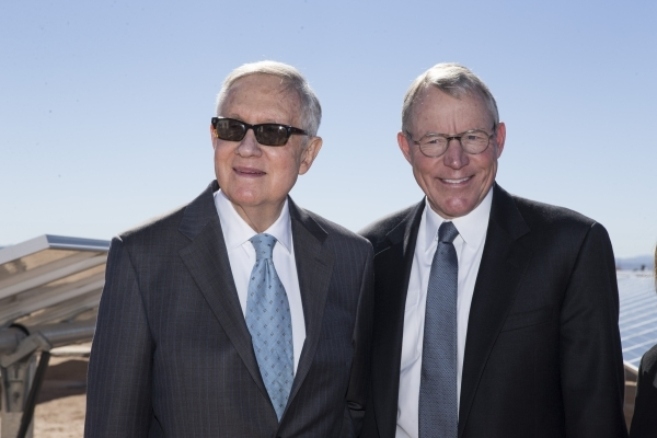 U.S. Rep. Harry Reid, D-Nev., left, and Paul Caudill, president and CEO of NV Energy, pose for photos following a dedication ceremony of the completed second solar-power project at Nellis Air Forc ...