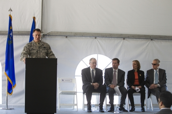 Col. Richard Boutwell, from left, 99th Air Base wing commander, speaks during a dedication ceremony of the completed second solar-power project at Nellis Air Force Base, with Paul Caudill, preside ...