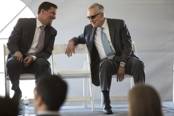 Tom Werner, left, CEO of SunPower, and U.S. Rep. Harry Reid, D-Nev., speaks to each other during a dedication ceremony of the completed second solar-power project at Nellis Air Force Base, a 15-me ...