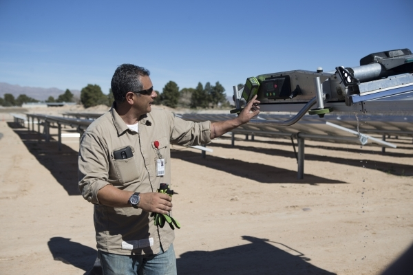 Oscar Madrigal, field supervisor with SunPower, gives a demonstration of a panel washing robot following a dedication ceremony of the completed second solar-power project at Nellis Air Force Base, ...