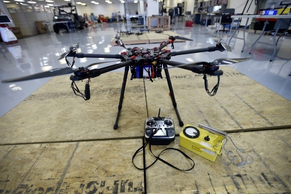 A hexarotor drone stands next to Geiger counter radiation detector at the UNLV Robotics Lab Tuesday, Feb. 16, 2016, in Las Vegas. The robotics lab is creating a drone that would contain sensors si ...
