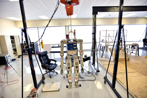 """Metal Rebel,"" one of the robots at the UNLV Robotics Lab, is displayed as it hangs from a chain lift Tuesday, Feb. 16, 2016, in Las Vegas. Metal Rebel is a humanoid robot which is desig ..."