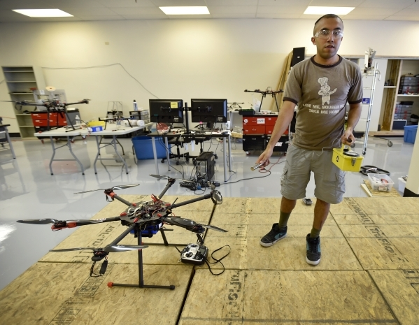 Mechanical engineer grad student Pareshkumar Brahmbhatt holds a Geiger counter radiation detector  while standing next to a hexarotor drone at the UNLV Robotics Lab Tuesday, Feb. 16, 2016, in Las  ...