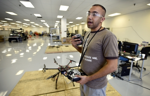 Mechanical engineer grad student Pareshkumar Brahmbhatt stands next to a hexarotor drone at the UNLV Robotics Lab Tuesday, Feb. 16, 2016, in Las Vegas. Brahmbhatt is creating a drone that would co ...