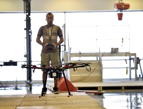 Mechanical engineer grad student Pareshkumar Brahmbhatt flies a hexarotor drone at the UNLV Robotics Lab Tuesday, Feb. 16, 2016, in Las Vegas. Brahmbhatt is creating a drone that would contain sen ...