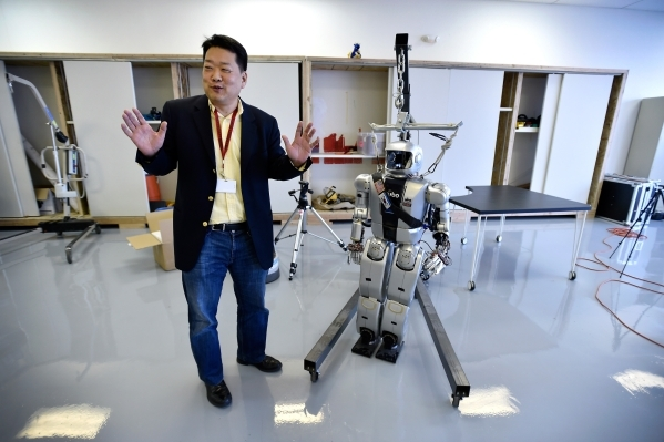 "UNLV mechanical engineer professor Paul Oh stands with ""Jamie"" one of the HUBO robots at the UNLV Robotics Lab Tuesday, Feb. 16, 2016, in Las Vegas. David Becker/Las Vegas Review-Journal ..."