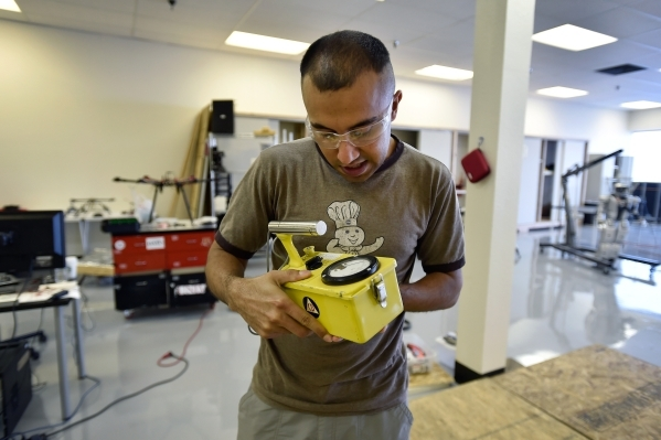 Mechanical engineer grad student Pareshkumar Brahmbhatt holds a Geiger counter radiation detector at the UNLV Robotics Lab Tuesday, Feb. 16, 2016, in Las Vegas. Brahmbhatt is creating a drone that ...