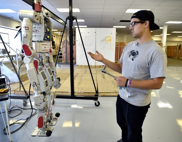 "Robotics student Santiago Ricoy shows off ""Metal Rebel,"" one of the robots at the UNLV Robotics Lab Tuesday, Feb. 16, 2016, in Las Vegas. Metal Rebel is a humanoid robot which is designe ..."