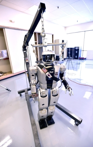 """Jamie"" one of the HUBO robots hangs from a chain at the UNLV Robotics Lab on Tuesday, Feb. 16, 2016, in Las Vegas. David Becker/Las Vegas Review-Journal Follow @davidjaybecker"