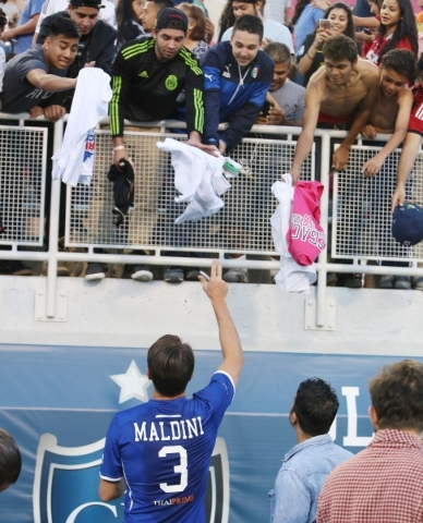 Fans throw their shirts to be autographed by Team Donovan's Paolo Maldini of Italy after the Global Legends Series match at Sam Boyd Stadium on Saturday, Feb. 20, 2016, in Las Vegas. Bizuaye ...
