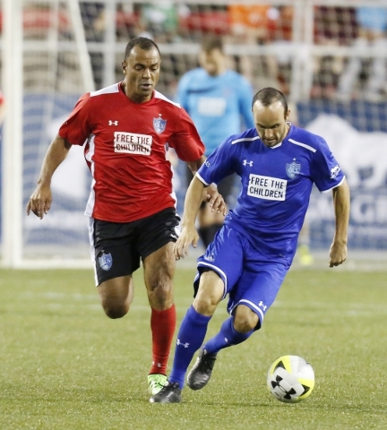 Team Donovan's Landon Donovan, right, drives past Team Figo's Cafu, left, of Brazil during the Global Legends Series match at Sam Boyd Stadium on Saturday, Feb. 20, 2016, in Las Vegas. ...