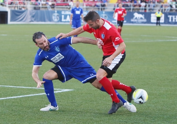 Team Donovan's Gianluca Zambrotta of Italy, left, battles for the ball against Team Figo's Alessandro Del Piero of Italy, right, during the Global Legends Series match at Sam Boyd Stad ...