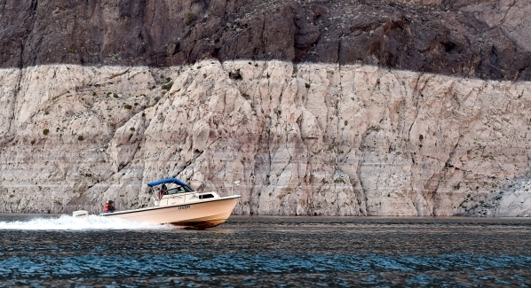 """A United States Bureau of Reclamation boat speeds along at Lake Mead on Tuesday, Jan. 12, 2016. As a long-term drought continues, a white """"bathtub ring"""" is formed from mineral deposits l ..."""
