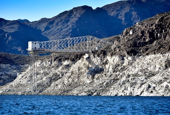 """The Basic Management Inc. intake pipe is seen high above the water lever at Lake Mead on Tuesday, Jan. 12, 2016. As a long-term drought continues, a white """"bathtub ring"""" on the rocks is  ..."""