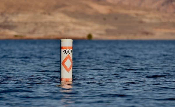 A buoy, warning boaters of submerged rocks, is seen during the annual eagle count at Lake Mead on Tuesday, Jan. 12, 2016. As a long-term drought continues and water  recedes, more warnings are bei ...