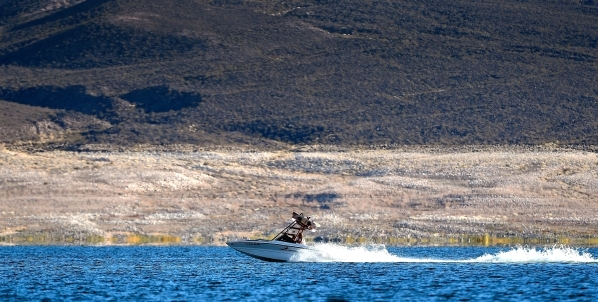 """A boat speeds along at Lake Mead on Tuesday, Jan. 12, 2016. As a long-term drought continues, a white """"bathtub ring"""" is formed from mineral deposits left after the water receded. David B ..."""