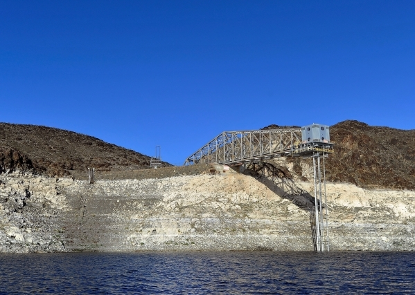 "The Basic Management Inc. intake pipe is seen high above the water lever at Lake Mead on Tuesday, Jan. 12, 2016. As a long-term drought continues, a white ""bathtub ring"" on the rocks is  ..."