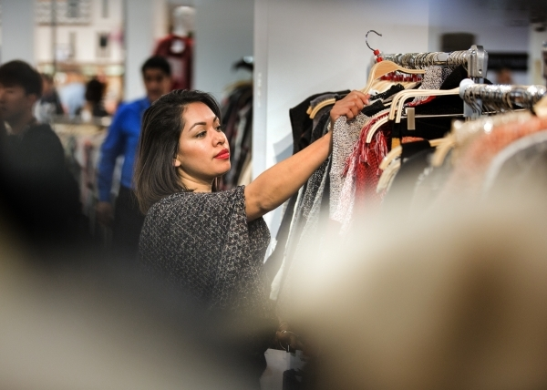 Lilian Hildalgo  pulls out the best selling clothing for costumers at the THML Clothing booth during the Men´s Apparel Guild in California show inside the Las Vegas Convention Center on Wednesday ...