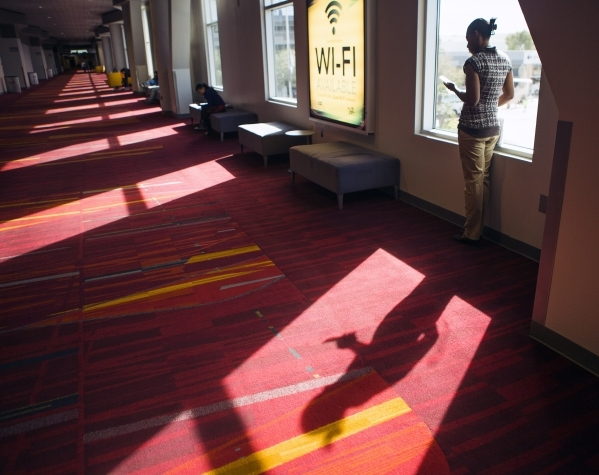 A woman looks at her mobile photo while standing inside the Las Vegas Convention Center on Wednesday, Feb. 17, 2016. Jeff Scheid/Las Vegas Review-Journal Follow @jlscheid