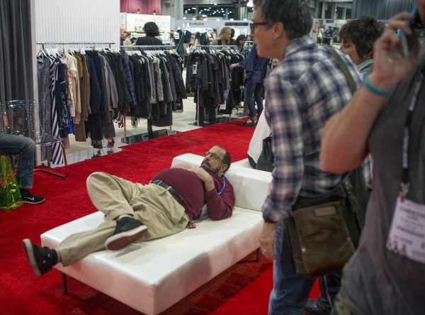 A man sleeps while attendees view the latest fashions during the Men´s Apparel Guild in California inside the Las Vegas Convention Center on Wednesday, Feb. 17, 2016. Jeff Scheid/Las Vegas Review ...
