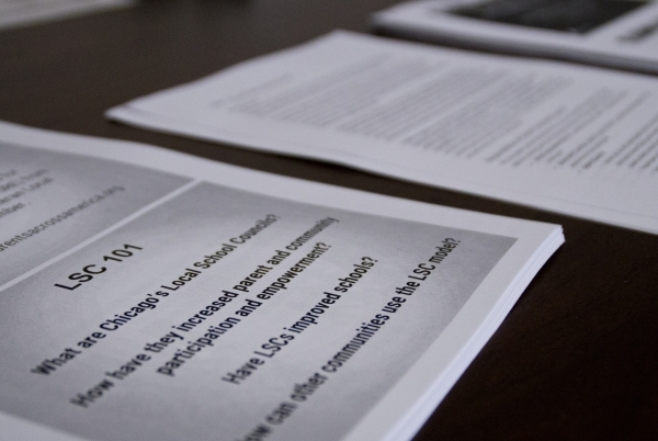 Documents pertaining to a presentation from Julie Woestehoff lie on a table during a meeting of the Technical Advisory Committee to Develop a Plan to Reorganize the Clark County School District in ...