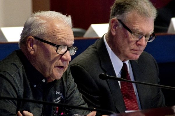 Dr. Larry Moses, a member of the Technical Advisory Committee to Develop a Plan to Reorganize the Clark County School District, asks a question during a meeting of the committee inside the Grant S ...